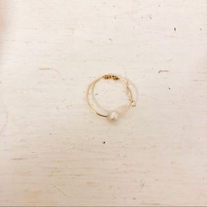 Delicate pearl ring on gold plated wire.